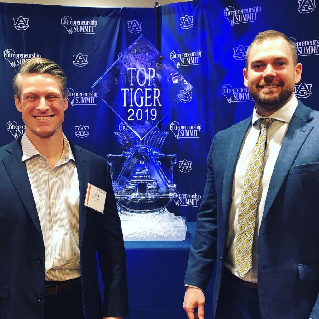 Trent Kocurek, CEO/Co-founder and Auburn University Alum (right), and Adam Aldrich, President / Co-founder (left), attend the 2019 Top Tigers awards luncheon at Auburn University